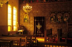 Photo: Norbert Schiller, the interior of the church Mar Girgis at Bilbays. In the corner stands a small model of the old church, which was built in the nineteenth century and replaced in the 1960s.
