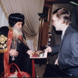 Pope Shenouda being presented with a special edition of Christianity Today.