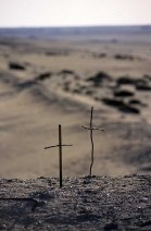 Photo: Norbert Schiller, crosses placed in the desert by pilgrims to Wadi al-Natrun