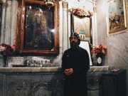 Photo: Paul Perry, a monk standing inside the prayer room of the residence of the monastery of the Syrians near the Cathedral of Klot Bek.