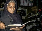Photo: Paul Perry, a poor elderly woman sitting in her shop near the residence of the monastery of Al - Syrian near the Cathedral of Klot Bek.