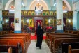 Photo: Shangyun Shen, a monk walking in the Chuch of Dayr al-Garnus