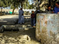 Photo: Paul Perry, Muslim villagers standing around the Holy Family well and tree. Christians no longer live in Al-Bahnassa.