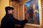 Photo: Norbert Schiller, a Coptic policeman seeking blessings from an Icon in the church at Maadi.