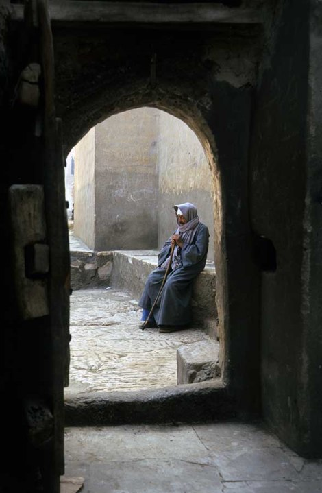 Photo: Norbert Schiller, a villager rests at the door of the Church of Abu Sefein in Dayr al-Maymun.