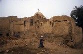 Photo: Norbert Schiller, a villager passes by the Church of Abu Sefein in Dayr al-Maymun.