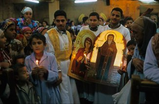 Photo: Norbert Schiller, parishioners parading new icons around the Church of Apa Hor after mass