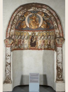 Photo: The Coptic Museum, dated to the 6th or 7th century, the external rim of this famous niche features a slightly protruding frame and two adjoining colonettes with simplified capitals. In the upper section Christ is enthroned in a mandorla (enclosed in an oval) carried on wheels with flames thrashing at its base. At the sides of the mandorla are the heads of the four creatures of the apocalypse that are also associated with the four evangelists: the eagle (St. John), ox (St. Luke), lion (St. Marc), and man (St. Matthew). The archangel Michael stands on the left while, Gabriel on the right. In the lower section the enthroned Holy Virgin, holding the infant Jesus, is flanked by the twelve apostles and two local saints.