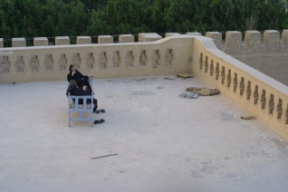 Photo: Popko van Meekeren, Coptic monks reposing on the rooftop of Dayr al-Muharraq.