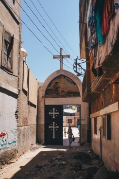 Photo: Shangyun Shen, gate of the church compound appearing at the end of an alley in Qusiya.